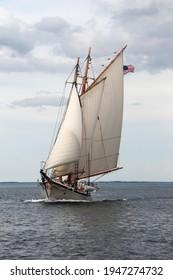A schooner under sail on the bay