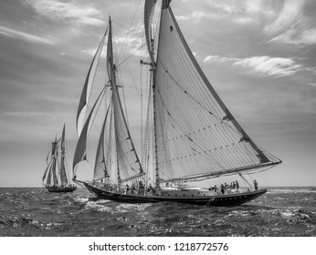 Schooners sail with full canvas in a good breeze of Gloucester, Massachusetts.