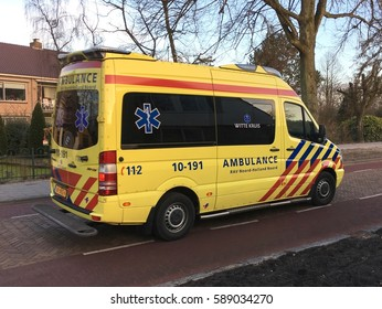 Schoorl, The Netherlands - February 19, 2017: Yellow Dutch Ambulance driving on a public road in the city of Schoorl.