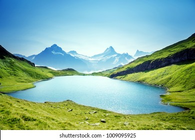 Schreckhorn and Wetterhorn from Bachalpsee lake, Bernese Oberland, Switzerland, Europe