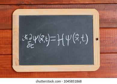 Schrodinger wave equation written on a blackboard