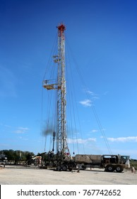 Schulenburg, Texas, November 11, 2017.  A crew of roughnecks sets up a servicing rig over an existing oil well for scheduled maintenance.