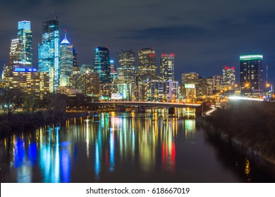 The Schuylkill River and skyline at night, in Philadelphia, Pennsylvania.