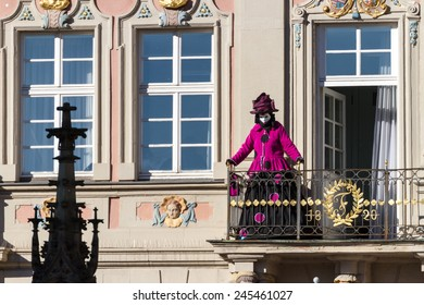 SCHWAEBISCH-HALL, GERMANY - February 23, 2014 - Person, dressed up in a Venetian style costume greets from a balcony at the Hallia Venetia Carnival festival on February 23, 2014 in Schw�¤bisch-Hall.