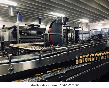 Schwaig, Germany, March 2018: beer bottle factory  filling the bottles with bier at privat brewery Schweiger