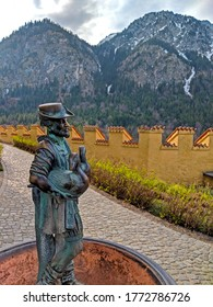 Schwangau, Germany - 04-07-2019 - This photo was taken in the Hohenschwangu Castle looking at one of the swan handler statues and back at the mountains which flank the castle.