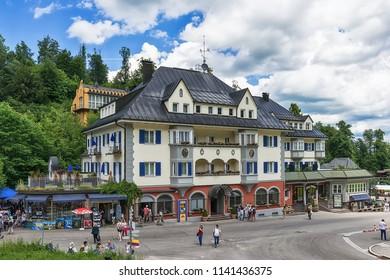 Schwangau, Germany June 10, 2018: Schwangau In Bavaria, Germany Under The Alps. Tourist place from where you go to Hohenschwangau Castle and Neuschwanstein Castle. Tourist Information Hohenschwangau.