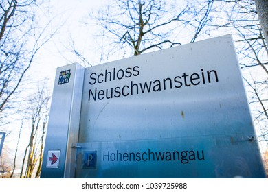 Schwangau, Germany - March 4, 2018: Tourist information sign at famous Neuschwanstein Castle in the Bavarian Alps of Germany.