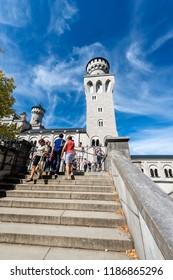 SCHWANGAU, GERMANY - SEPTEMBER 9th, 2018: Neuschwanstein Castle (New Swanstone Castle - Schloss Neuschwanstein XIX century), landmark in the Bavarian Alps, Germany.