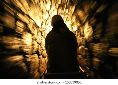 SCHWAZ, AUSTRIA - MARCH 24 : Blur motion of tourists explore mine using mini railway through the tunnel at Silver Mine, Silberbergwerk on March 24, 2013. It's the biggest silver mine of Middle Ages