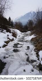 Schwaz Tyrol Austria - water channel - creek with ice and snow