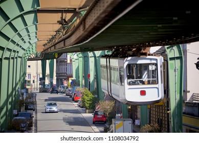 Schwebebahn car departs station in Wuppertal, Germany
