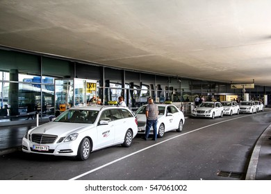 SCHWECHAT, AUSTRIA - JULY 24, 2014: Parking of the taxi cars near the Vienna-Schwechat International Airport.