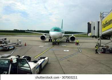 SCHWECHAT, AUSTRIA - MAY 30: Unidentified employes, aircraft, equipment and passenger boarding bridge on Vienna airport, on May 30, 2015 in Schwechat, Austria
