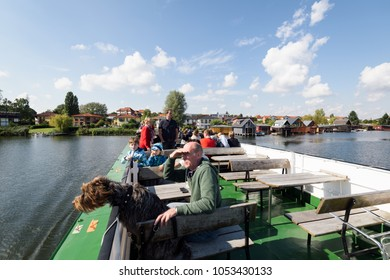 Schwerin; Germany - Sept 10; 2017: Tourist on a boat are enjoying the view on the Heidensee (lake); in Schwerin; Germany.