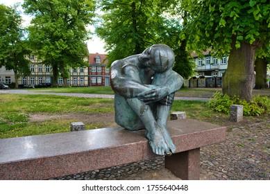 Schwerin, Mecklenburg-Vorpommern / Germany - June 6, 2020: Woman statue in from of Schelfchurch in Schwerin