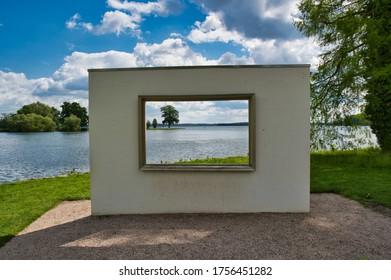 Schwerin, Mecklenburg-Vorpommern / Germany - June 6, 2020: Park garden of Schwerin Castle with a window frame