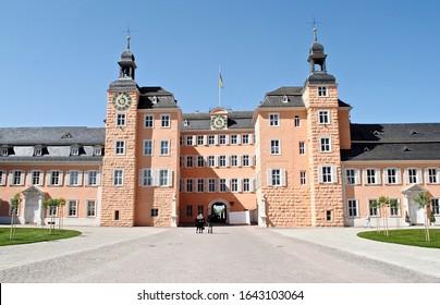 Schwetzingen, Germany - 2015: Entrance to Schloss Schwetzingen, or Schwetzingen Palace is a schloss in the German state of Baden-Württemberg. Coral or pink palace entrance.