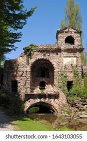 Schwetzingen, Germany - 2015: Schloss Schwetzingen, or Schwetzingen Palace is a schloss in the German state of Baden-Württemberg. Artificial Roman ruins of aqueducts accent the formal garden.