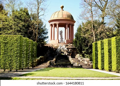 Schwetzingen, Germany - 2015: Schloss Schwetzingen is a schloss or palace in the German state of Baden-Württemberg. The Apollo temple is above the natural theater, a small round temple on rock hill.