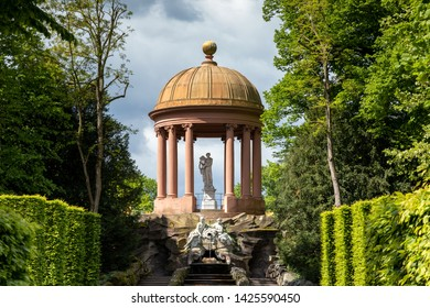 SCHWETZINGEN, GERMANY - MAY 05, 2019: The Apollo temple in the famous baroque palace garden of Schloss Schwetzingen