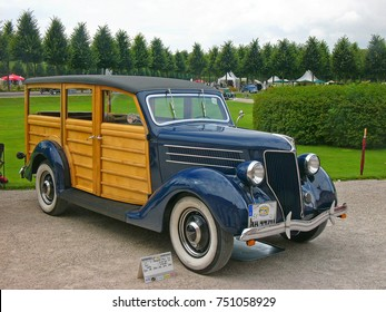 SCHWETZINGEN, GERMANY, SEPTEMBER 1, 2007. A Ford V8 Model 68 Woody wagon built in USA in 1936  photographed at a car event in Germany
