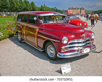 SCHWETZINGEN, GERMANY, SEPTEMBER 1, 2007. A red Plymouth Suburban Woody station wagon, built in USA in 1950, shown at a classic car event in Germany