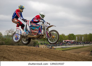 Groß Schwiesow, Germany - March 01,2019 - Motocross racer with sidecar jumps in the air over a sand hill