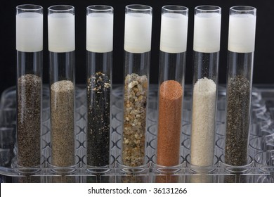 science abstract - glass testing tubes with different sand samples collected from beaches and deserts of western USA and Hawaii