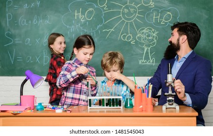Science is always the solution. Observe reaction. School chemistry experiment. Fascinating chemistry lesson. Man bearded teacher and pupils with test tubes in classroom. Explaining chemistry to kids.
