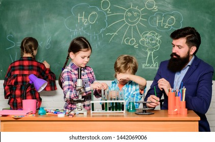 Science is always the solution. School chemistry experiment. Explaining chemistry to kids. Fascinating chemistry lesson. Man bearded teacher and pupils with test tubes in classroom. Observe reaction.