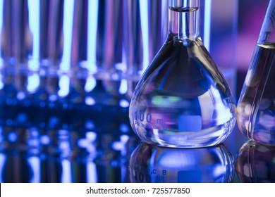 Science concept. Laboratory beakers. Colorful bokeh.