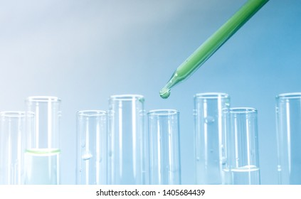 Science experiment equipment. Pipettes take samples to a test tube containing chemicals.