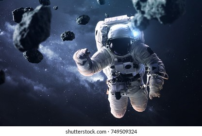 Science fiction space wallpaper with astronaut at the spacewalk. Elements of this image furnished by NASA