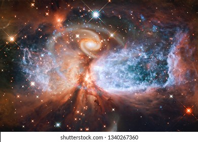 Science fiction space wallpaper, galaxies and nebulas in awesome cosmic image. Elements of this image furnished by NASA