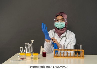 Science lab concept, Cute Malay Woman wearing glove and face mask