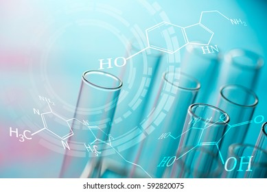 science laboratory test tubes with chemical formula , science background