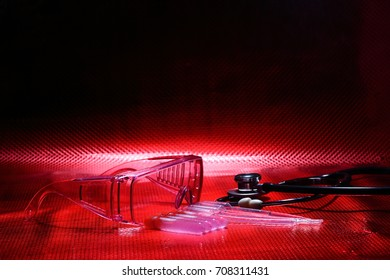 Science Medical R & D, dropper, goggle, stethoscope, Glass Tube Lab Test tools, Studio lighting reddish background copy space, red tone concept