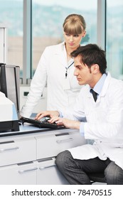 science and research biology chemistry an dmedicine  youn people couple in bright modern  lab