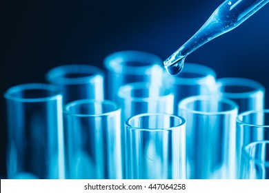 science research concept,Dropping chemical liquid to test tube,