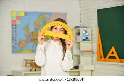 Science and Technology. Mathematics matters. Small child holding ruler for mathematics lesson. Cute little schoolgirl with geometrical tool for mathematics. Elementary school mathematics or maths.