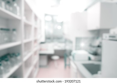 Scientific background: modern laboratory interior out of focus, text space