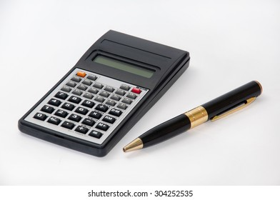 Scientific calculator and golden pen.