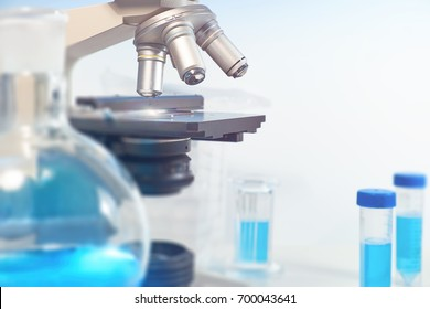 Scientific, medical or education background. Biological or biochemical lab out of focus, closeup on the microscope lenses