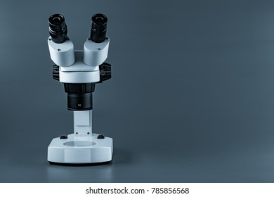 Scientific microscopes on blue background