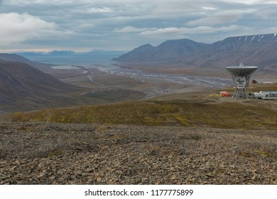 Scientific observatory with large dish to explore the arctic northern lights above Adbentdalen, Svalbard, Northern Norway