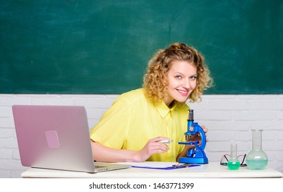 Scientific research. Microbiology concept. Student girl with laptop and microscope. Molecular biology PhD projects. Scientist microbiology. Study microbiology. Investigate molecular modifications.