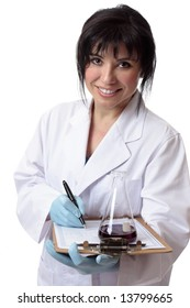 A scientist, chemist or laboratory worker with data worksheet and laboratory equipment.  She is looking up and smiling cheerfully.