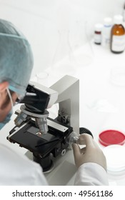 Scientist conducting genetic research of blood sample in laboratory selective focus