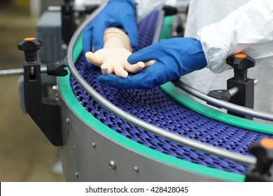 scientist at conveyor belt controlling  artificial bionic hand . a concept of spare body parts mass production